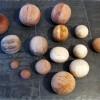 28 Memory motion 2008, 15 wooden pebbles, from 26cm dia. to 8cm dia. ash, cherry, pear, walnut, mahogony, beach